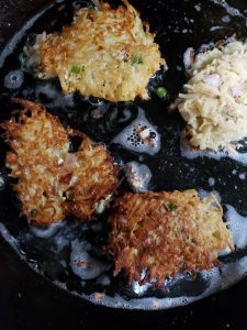 latkes cooking in the cast iron