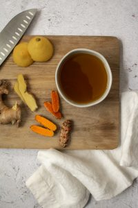 ginger turmeric honey syrup with chopped pieces