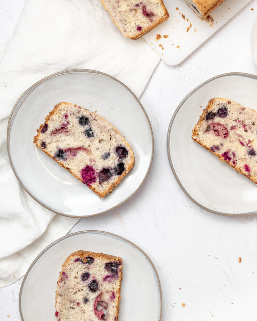 slices of triple berry loaf on plates